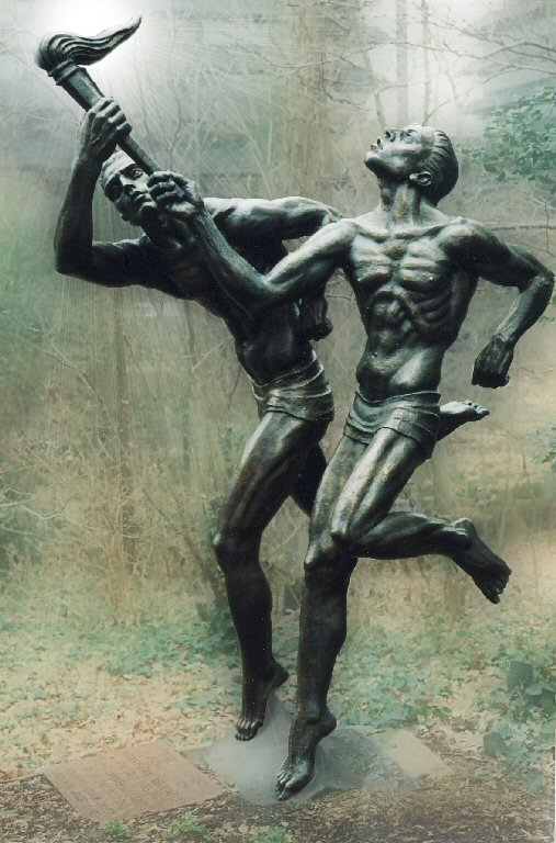 The Torchbearers by Charles Umlauf depicts the teacher passing the torch of knowledge to the student.